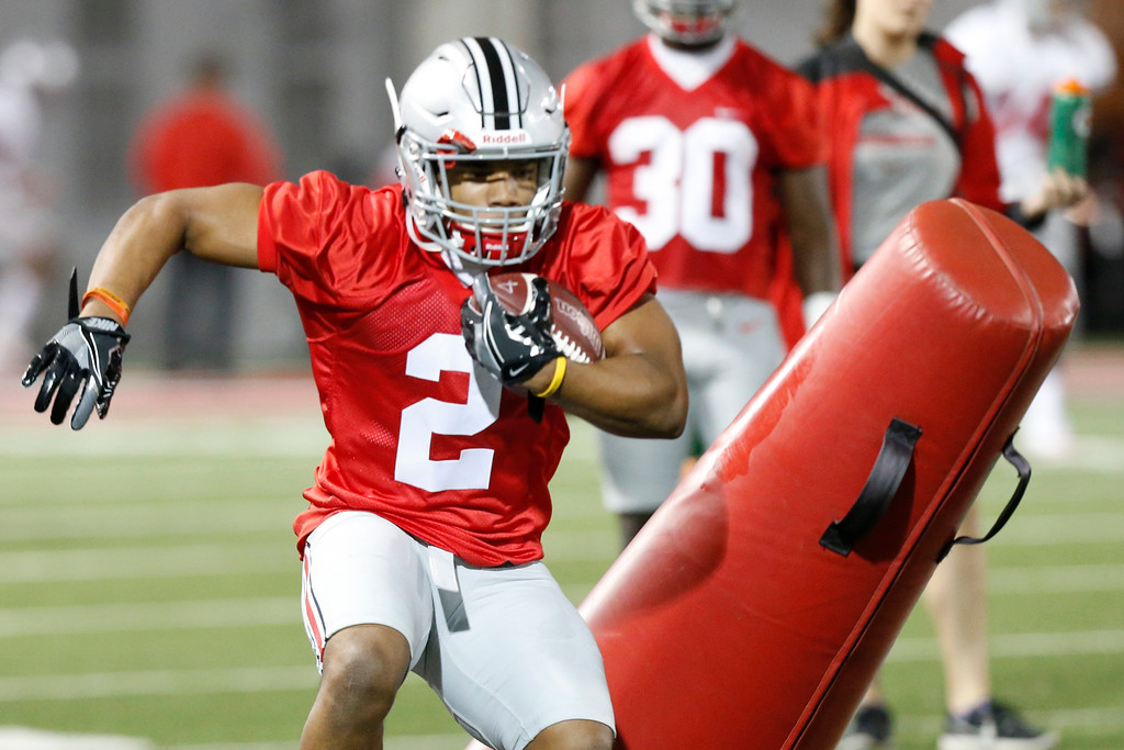 . Ohio State running back J.K. Dobbins runs a drill during their Spring NCAA college football practice Tuesday, March 7, 2017, in Columbus, Ohio. (AP Photo/Jay LaPrete)