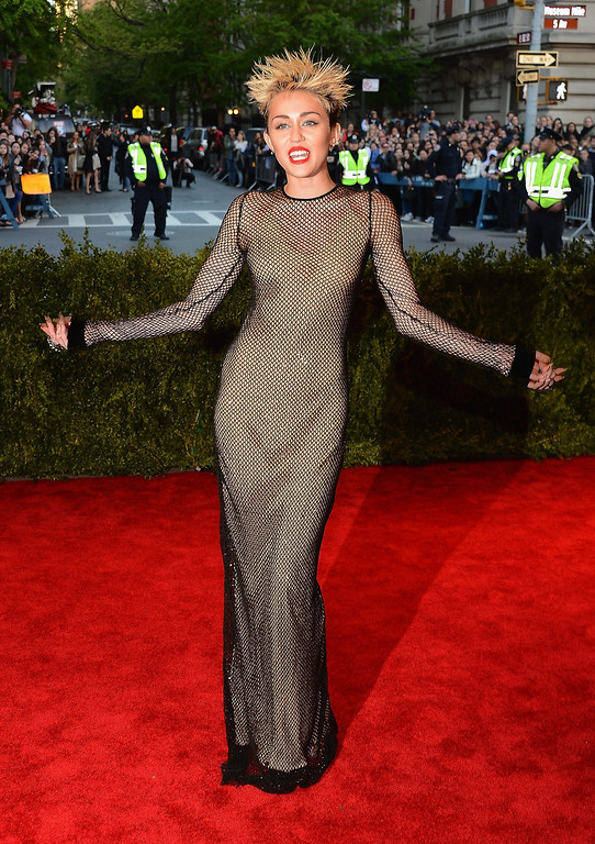 """. Miley Cyrus attends the Costume Institute Gala for the \""""PUNK: Chaos to Couture\"""" exhibition at the Metropolitan Museum of Art on May 6, 2013 in New York City.  (Photo by Larry Busacca/Getty Images)"""