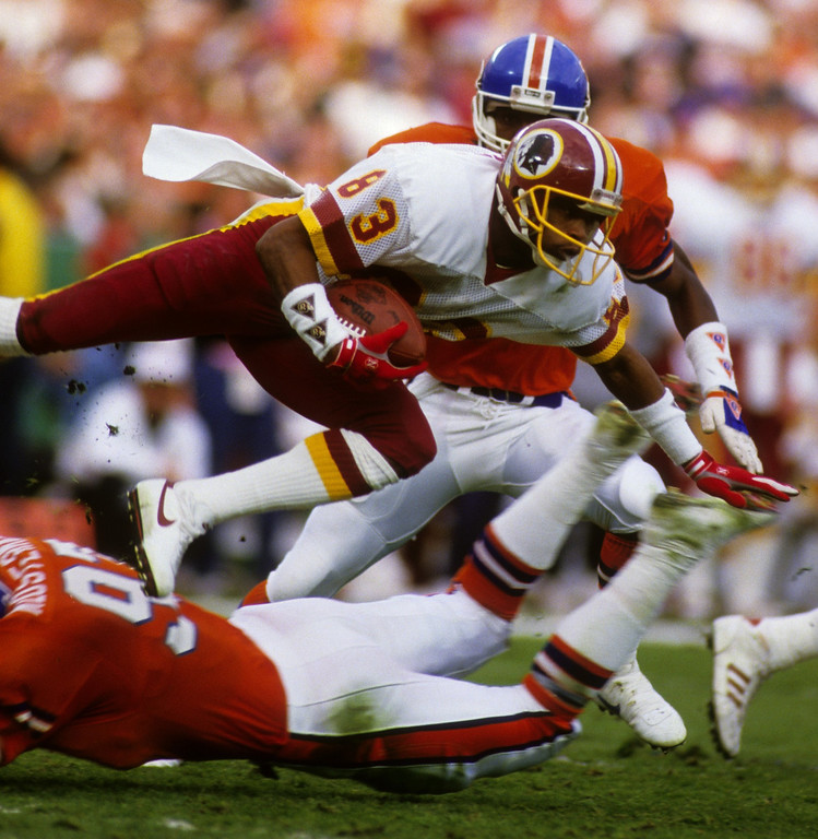. Wide receiver Ricky Sanders #83 of the Washington Redskins returns a kickoff under pressure from the Denver Broncos during Super Bowl XXII at Jack Murphy Stadium on January 31, 1988 in San Diego, California.   (Photo by George Rose/Getty Images)