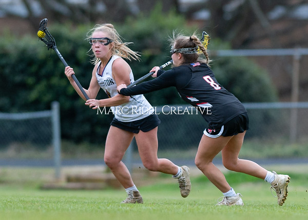 Broughton girls varsity lacrosse vs Middle Creek. February 28, 2020. D4S_0283