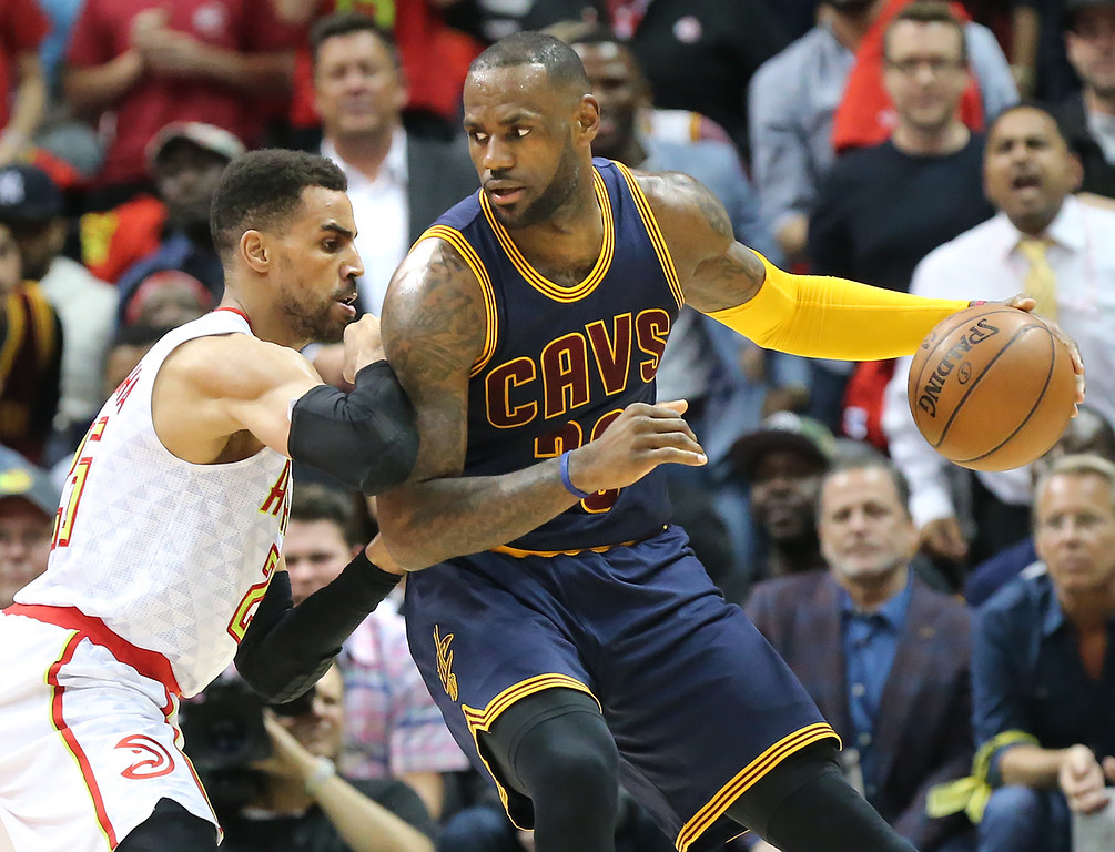 . Atlanta Hawks Thabo Sefolosha, left, defends against Cleveland Cavaliers LeBron James during the second period in Game 3 of a second-round NBA basketball playoff series Friday, May 6, 2016, in Atlanta. (Curtis Compton/Atlanta Journal-Constitution via AP)