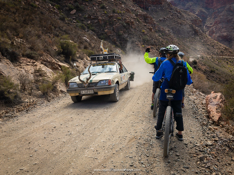 Mountain biking and car from the Nuts and Bolts Rally on Swartberg Pass. Prince (Prins) Albert. Western Cape. South Africa
