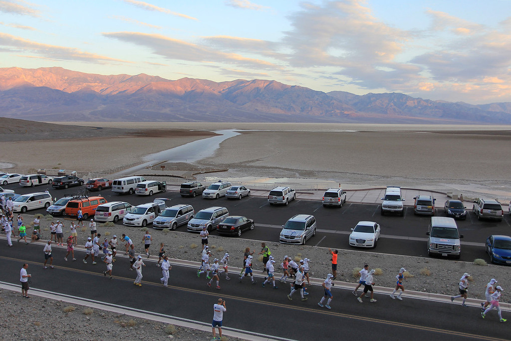 . The first of three waves of runners start at the AdventurCORPS Badwater 135 ultra-marathon race on July 15, 2013 in Death Valley National Park, California. Billed as the toughest footrace in the world, the 36th annual Badwater 135 starts at Badwater Basin in Death Valley, 280 feet below sea level, where athletes begin a 135-mile non-stop run over three mountain ranges in extreme mid-summer desert heat to finish at 8,350 feet above sea level near Mount Whitney for a total cumulative vertical ascent of 13,000 feet. July 10 marked the 100-year anniversary of the all-time hottest world record temperature of 134 degrees, set in Death Valley where the average high in July is 116. A total of 96 competitors from 22 nations are attempting the run which equals about five back-to-back marathons. Previous winners have completed all 135 miles in slightly less than 24 hours.  (Photo by David McNew/Getty Images)