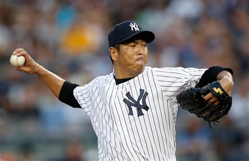 . New York Yankees starting pitcher Hiroki Kuroda delivers in the first inning of a baseball game against the Detroit Tigers at Yankee Stadium in New York, Tuesday, Aug. 5, 2014.  (AP Photo/Kathy Willens)