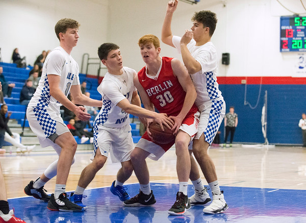 12/27/19 Wesley Bunnell | StaffrrBerlin boys basketball defeated Plainville on Friday night at Plainville High School. Berlin's Ben Lincoln (30) fights for a rebound with Plainville's Louis Passarett (4) and Cameron LaMothe (14).