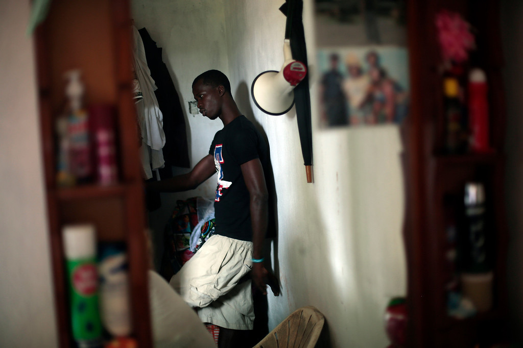 . John Tamba, 17, stands  in his uncle\'s house in the St Paul\'s Bridge neighborhood of Monrovia, Liberia, Friday Sept. 26, 2014. John lost both parents to the Ebola Virus.  (AP Photo/Jerome Delay)