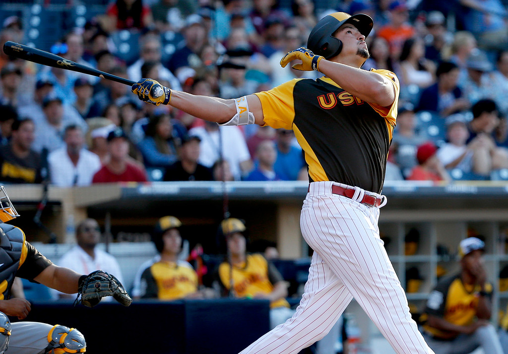 . U.S. Team\'s Dylan Cozens, of the Philadelphia Phillies, hits against the World Team during the XXX inning of the All-Star Futures baseball game, Sunday, July 10, 2016, in San Diego. (AP Photo/Lenny Ignelzi)