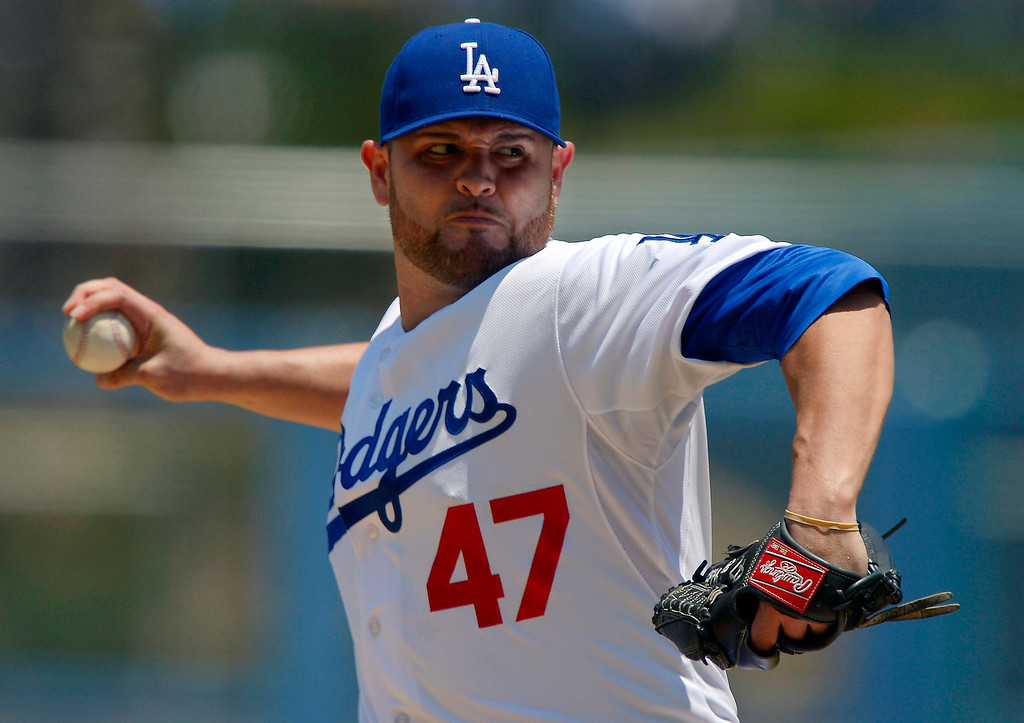 . Los Angeles Dodgers starting pitcher Ricky Nolasco throws to the plate during the first inning of their baseball game against the Colorado Rockies, Sunday, July 14, 2013, in Los Angeles. (AP Photo/Mark J. Terrill)