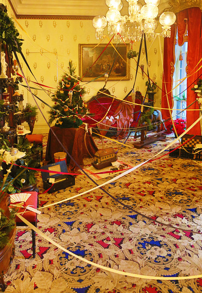 Children's Christmas presents, linked for each child by tapes.   This is the Belter Parlor.