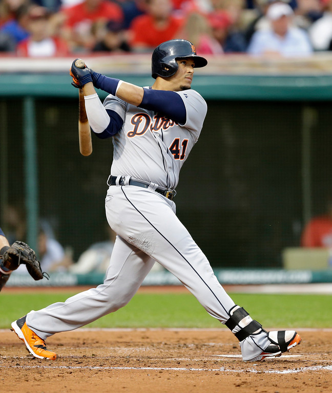. Detroit Tigers\' Victor Martinez hits a two-run home run off Cleveland Indians starting pitcher Corey Kluber in the fourth inning of a baseball game, Friday, June 20, 2014, in Cleveland. Miguel Cabrera scored. (AP Photo/Tony Dejak)