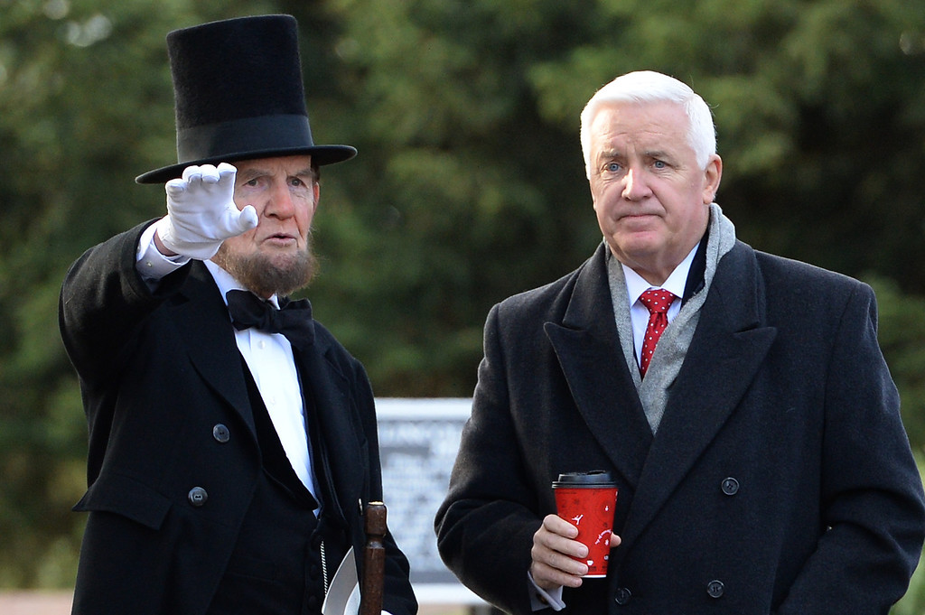 . Portraying U.S. President Abraham Lincoln, James Getty (left), speaks to Pennsylvania Governor Tom Corbett during a commemoration of the 150th Anniversary of the Gettysburg Address at the Soldiers\' National Cemetery at Gettysburg National Military Park on November 19, 2013 in Gettysburg, Pennsylvania.(Photo by Patrick Smith/Getty Images)