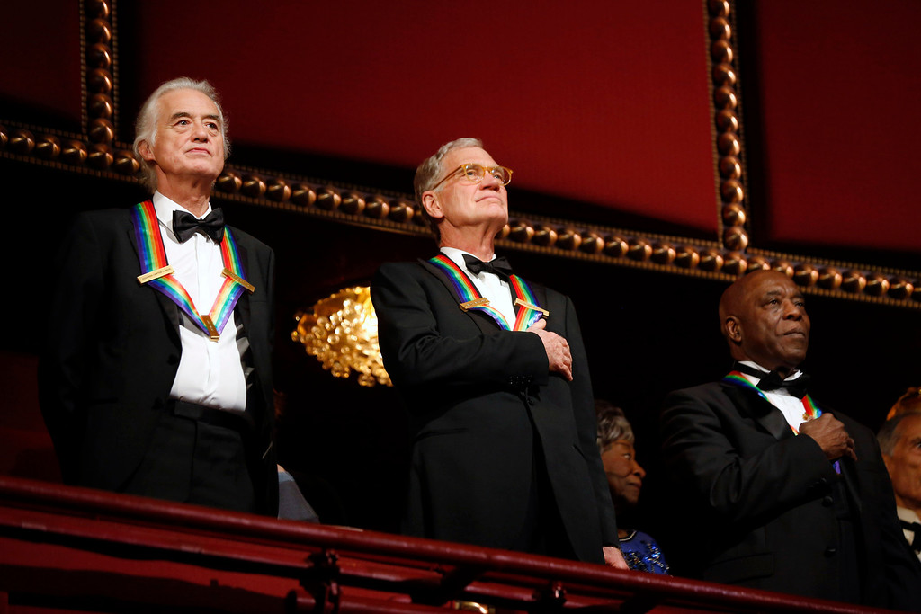 ". Kennedy Center honorees (L-R) Led Zeppelin band member Jimmy Page, late-night TV host David Letterman and blues musician George ""Buddy\"" Guy appear on the balcony as they attend the 2012 Kennedy Center Honors at the Kennedy Center in Washington, December 2, 2012.     REUTERS/Jason Reed"