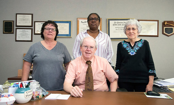 10/01/19 Wesley Bunnell | StaffrrEmployees of Fulco, DiTommaso, McMahon & Co. Patrick McMahon C.P.A , seated, Accountant Lynn Belval, L, Receptionist Valeria Hubert, and Secretary Judy DiTommaso.
