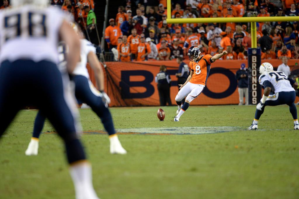 . DENVER, CO - OCTOBER 23: Brandon McManus (8) of the Denver Broncos kicks off after Emmanuel Sanders (10) of the Denver Broncos touchdown during the second quarter. The Denver Broncos played the San Diego Chargers at Sports Authority Field at Mile High in Denver on October 23, 2014. (Photo by Tim Rasmussen/The Denver Post)