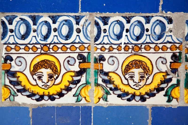 Cherubs on old glazed ceramic tiles, Fine Arts Museum, Seville, Spain