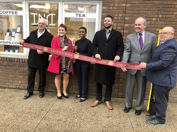 Ribbon Cutting for INI Sips