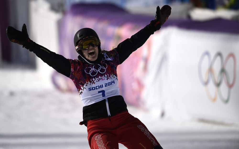 . Gold Medallist, Switzerland\'s Patrizia Kummer celebrates in the Women\'s Snowboard Parallel Giant Slalom Final at the Rosa Khutor Extreme Park during the Sochi Winter Olympics on February 19, 2014.    FRANCK FIFE/AFP/Getty Images