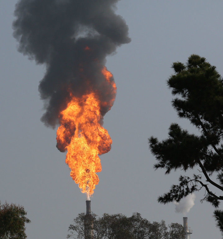 . An explosion and fire in a gasoline processing unit rocked the ExxonMobil refinery in Torrance Feb. 18, 2015, injuring workers and sending flames and ash into the sky. (Chuck Bennett/Daily Breeze)