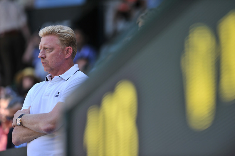 . German former champion tennis player Boris Becker, coach of Serbia\'s Novak Djokovic, watches Djokovic warm up before his men\'s singles semi-final match against Bulgaria\'s Grigor Dimitrov on day 11 of  the 2014 Wimbledon Championships at The All England Tennis Club in Wimbledon, southwest London, on July 4, 2014. (GLYN KIRK/AFP/Getty Images)