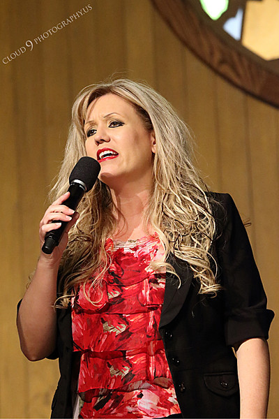 AMER-CMM 00017 Heritage Singers Lisa Jensen sings before a church audience by Peter J Mancus.JPG