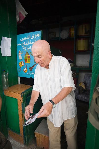 Medina dealer explaining his business, Tetouan, Morocco