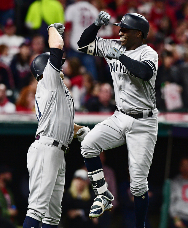 . New York Yankees\' Didi Gregorius, right, is congratulated by Brett Gardner after Gregorius hit a two-run home run off Cleveland Indians starting pitcher Corey Kluber during the third inning of Game 5 of a baseball American League Division Series, Wednesday, Oct. 11, 2017, in Cleveland. Gardner scored on the play. (AP Photo/David Dermer)