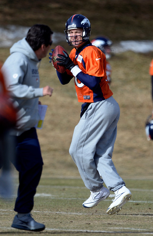 . Denver Broncos quarterback Peyton Manning (18) drops back to pass during practice January 16, 2014 at Dove Valley. The Denver Broncos are preparing for their AFC Championship game against the New England Patriots at Sports Authority Field.  (Photo by John Leyba/The Denver Post)