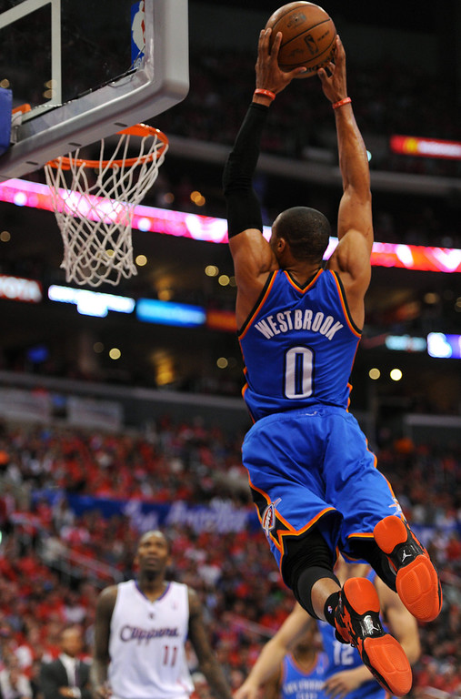 . Thunder point guard Russell Westbrook skies along the baseline for a dunk against the Clippers, Friday, May 9, 2014, at Staples Center. (Photo by Michael Owen Baker/Los Angeles Daily News)