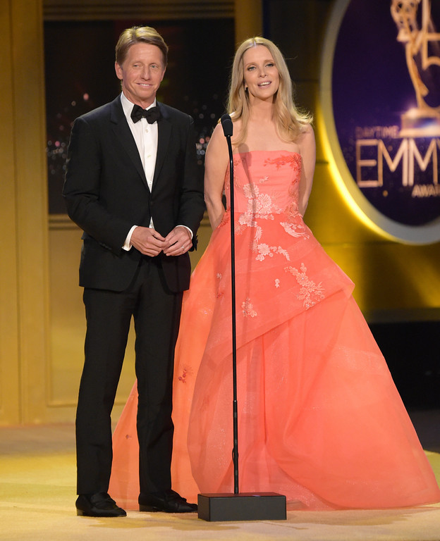 ". Brad Bell, left, and Lauralee Bell present a tribute to ""The Young and the Restless\"" at the 45th annual Daytime Emmy Awards at the Pasadena Civic Center on Sunday, April 29, 2018, in Pasadena, Calif. (Photo by Richard Shotwell/Invision/AP)"