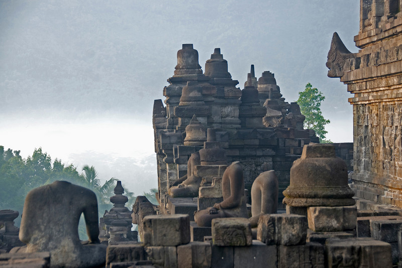 Shot of the headless statues and beautiful skyline at Borobudur Temple