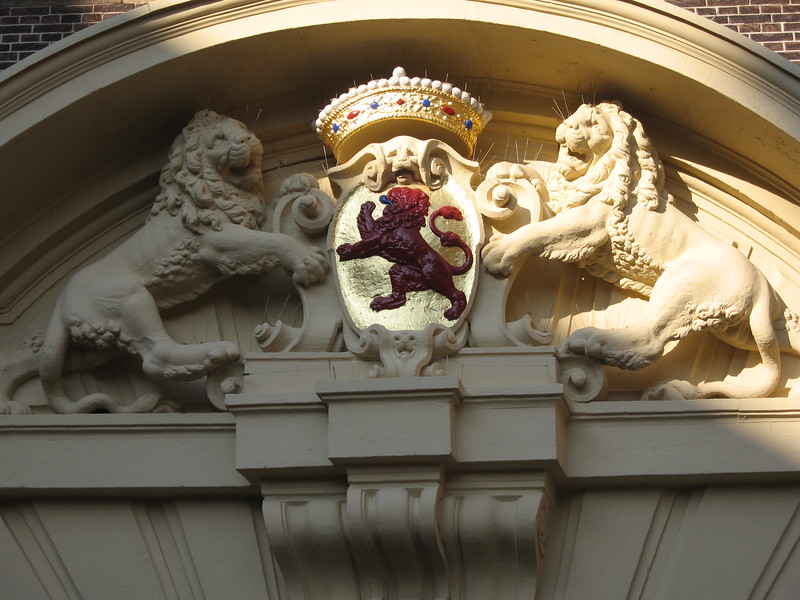Portion of the Greater Coat of Arms of the Realm on a building of the Binnenhof (Inner Court), the complex housing the Staten-Generaal (Dutch Parliament)