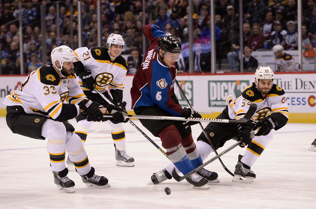 . DENVER, CO - JANUARY 21: Colorado Avalanche defenseman Erik Johnson (6) gets caught between Boston Bruins defenseman Zdeno Chara (33) Boston Bruins defenseman Adam McQuaid (54) as he pokes the puck away during the first period January 21, 2015 at Pepsi Center. (Photo By John Leyba/The Denver Post)