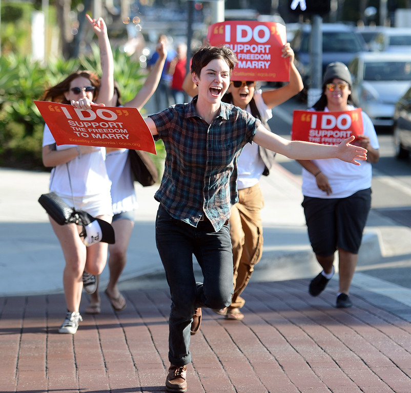 . People celebrate along Santa Monica Blvd in West Hollywood after the Supreme Court struck down the Defense of Marriage Act and and allowed a lower court ruling to stand that struck down California\'s Proposition 8 ballot initiative Wednesday, June 26, 2013. (Hans Gutknecht/Los Angeles Daily News)