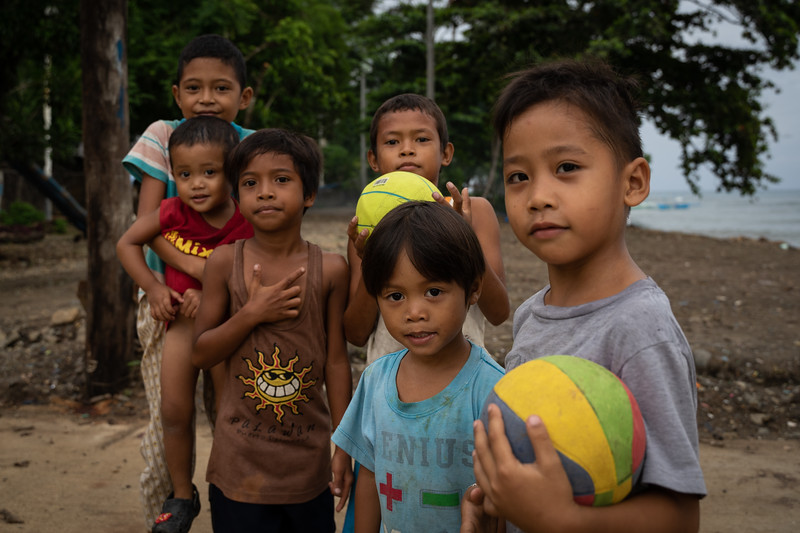 A group of children in Puerta Princessa, Philippines — near the famous underground river — pause their basketball game.