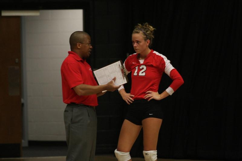 Coach Leo Sayles talks to number 12, Evan Moffitt.