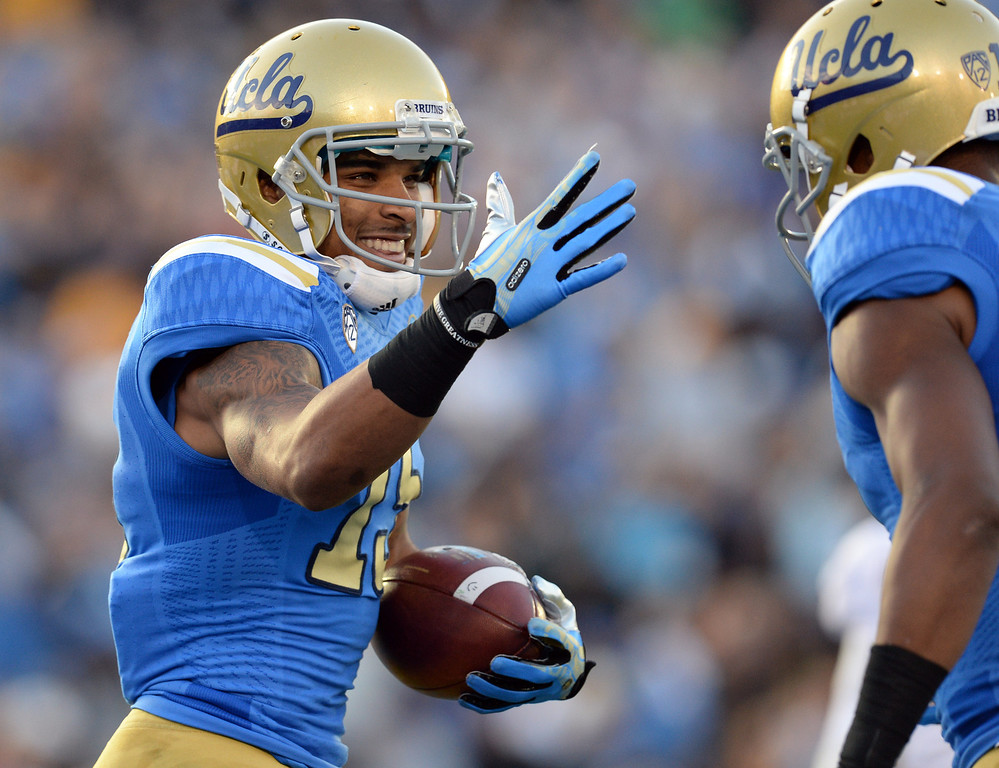 . UCLA�s Devin Lucien #15 smiles after hauling in a first half touchdown pass during their game against Arizona State�s at the Rose Bowl Saturday November 23, 2013. (Photos by Hans Gutknecht/Los Angeles Daily News)
