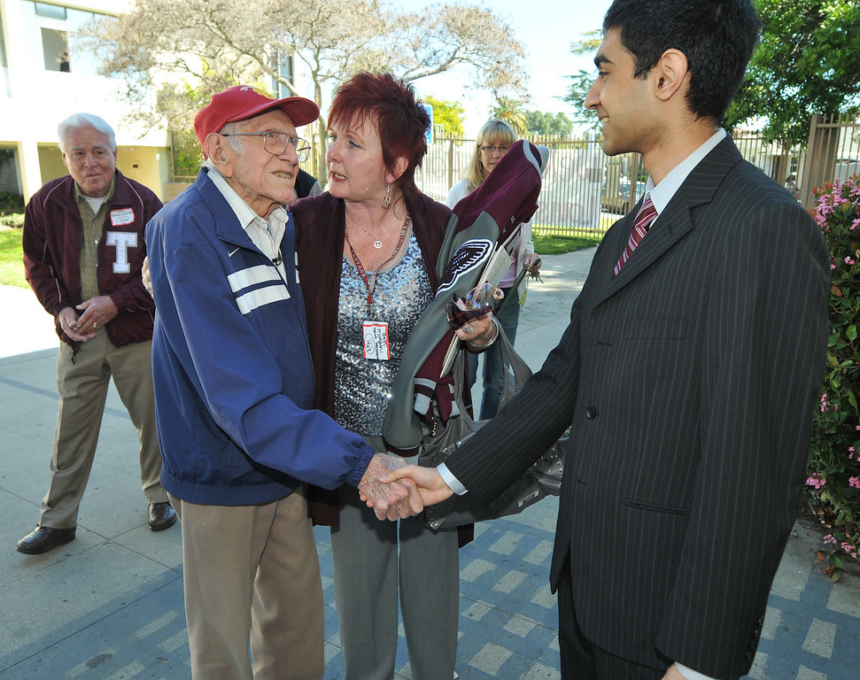. Torrance---3/31/11---Daily Breeze Photo:  Robert Casillas ---  Torrance legend Louis Zamperini paid a visit to his alma mater Torrance High to visit with alumni and meet students.Zamperini is introduced to Torrance ASB president Danish Akmal by Alumni pres. Gail Morgan.