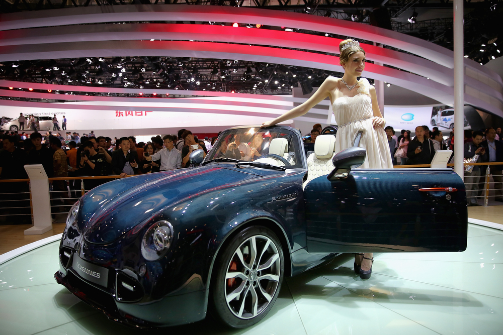 . A model stands beside a PGO Cevennes sport car during the 2014 Beijing International Automotive Exhibition at China International Exhibition Center on April 22, 2014 in Beijing, China. More than 2,000 automotive enterprises from 14 countries and regions participated in the 2014 Beijing International Automotive Exhibition from April 20 to April 29.  (Photo by Feng Li/Getty Images)