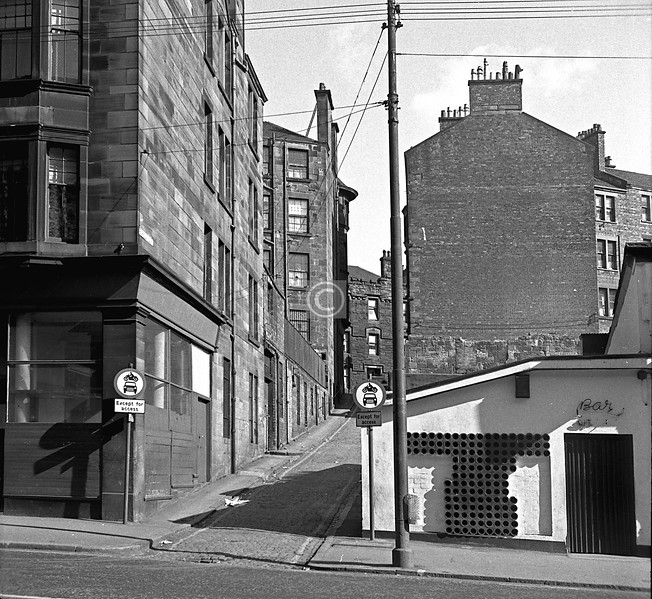 Burrell's Lane from Duke St.   Little has changed, except for the building glimpsed on the far side of Castle St. which was some living accommodation attached to the Pumping Station.    April 1973
