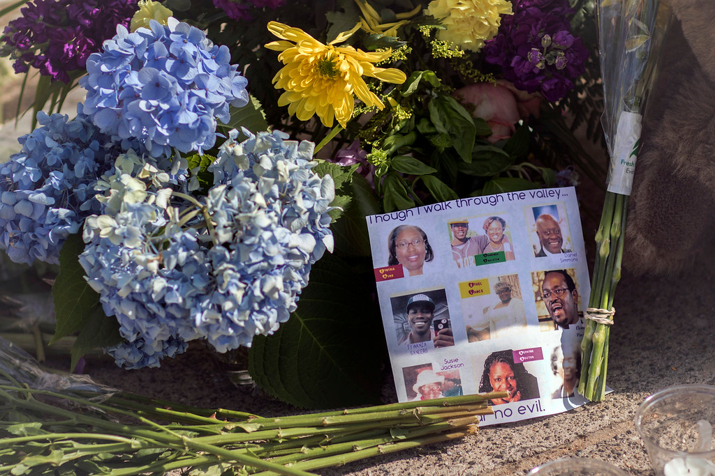 . Flowers and notes of hope and support from the community line the sidewalk, Friday, June 19, 2015  in front of the  Emanuel AME Church in Charleston, S.C. Dylann Storm Roof, 21, is accused of killing nine people during a Wednesday night Bible study at the church.  (AP Photo/Stephen B. Morton)