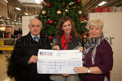 Jolene O'Hare and her Uncle Gerry Carr present a cheque for £5000 to Linda Alexander from Cystic Fibrosis trust, money which was raised at a spinathon held in Mourne Fitness on teh 15th November. R1551003