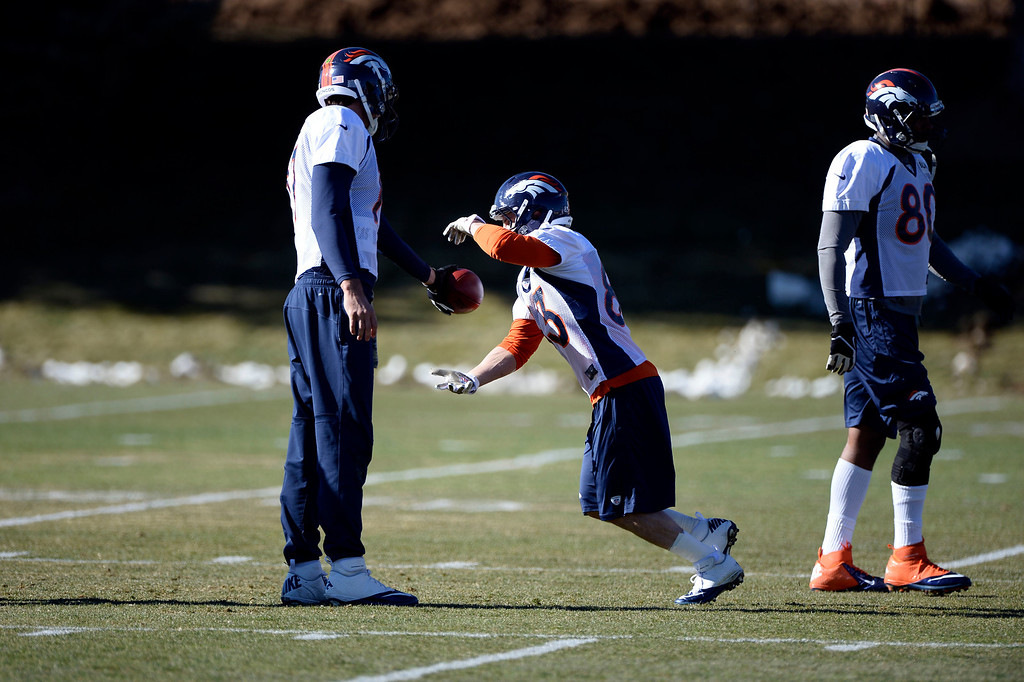. Denver Broncos quarterback Brock Osweiler (17) hands off the football to Denver Broncos wide receiver Wes Welker (83) during drill at practice November 27, 2013 at Dove Valley (Photo by John Leyba/The Denver Post)