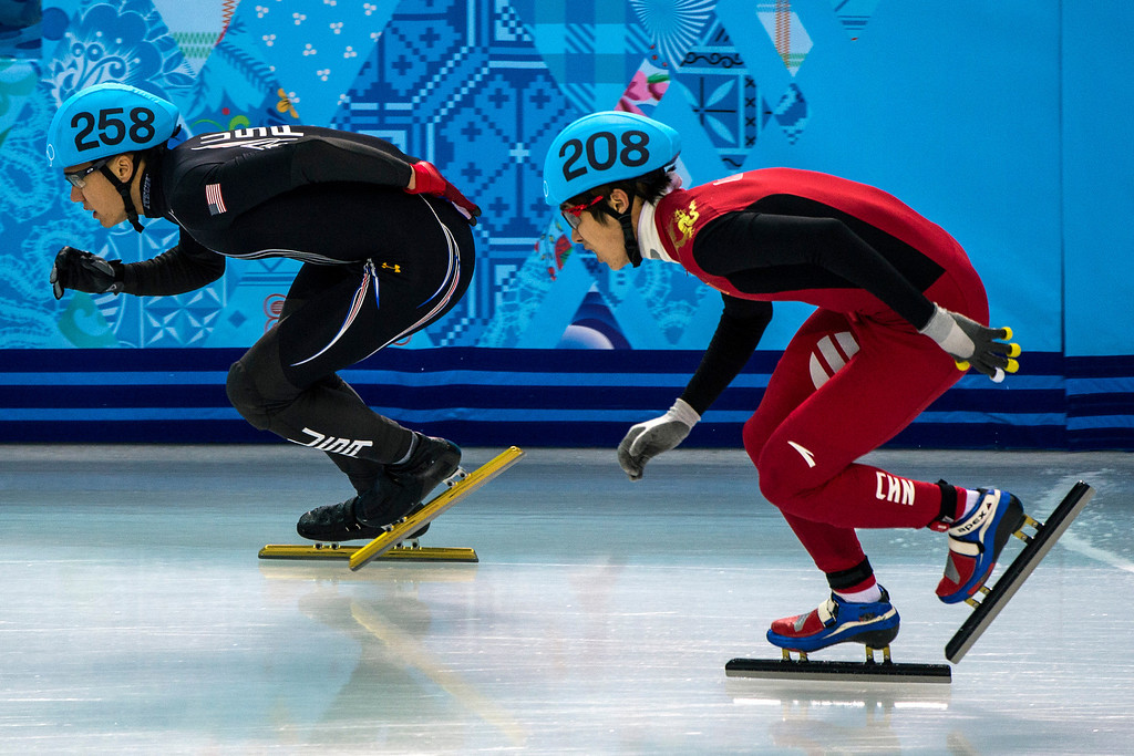 . J.R. Celski, of Salt Lake City, and Dequan Chen, of China, (208) compete in the 1,500-meter short-track speedskating finals at Iceberg Skating Palace during the 2014 Sochi Olympic Games Monday February 10, 2014. Celski finished in fourth place with a time of 2:15.624, 0.639 behind gold medalist Charles Hamelin of Canada. (Photo by Chris Detrick/The Salt Lake Tribune)