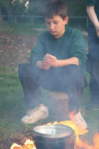 Rikki boil eggs on fires