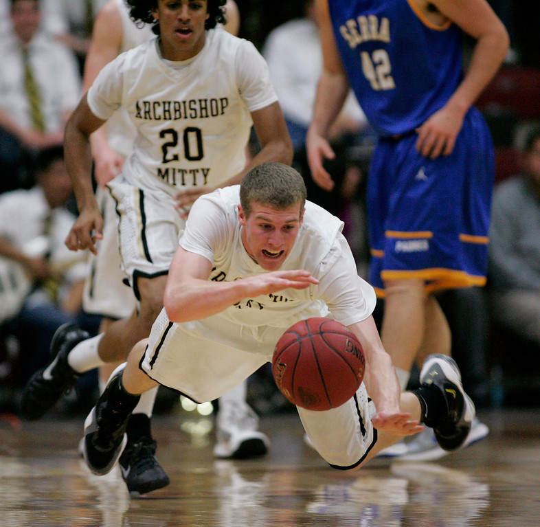 . Mitty\'s Connor Peterson dives for a ball in the second quarter during the CCS Open Division boys basketball finals at Santa Clara University in Santa Clara, Calif. on Saturday, March 2, 2013. The Archbishop Mitty Monarchs played the Serra Padres. (Jim Gensheimer/Staff)