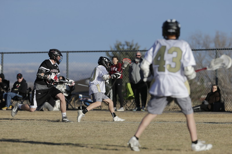 JPM0293-JPM0293-Jonathan first HS lacrosse game March 9th.jpg