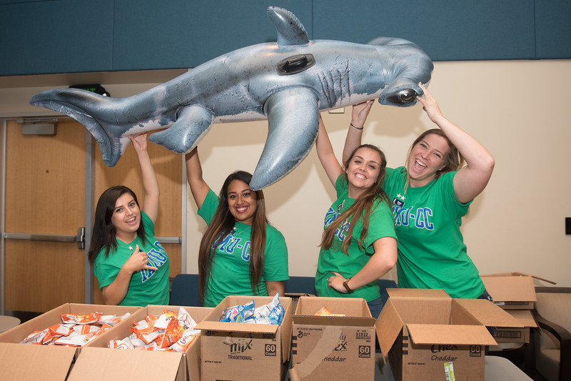 Orientation Leaders Karen Velasco (left) Karla Calderon, Sphia Zaner and Ana Norris show their excitment for Shark Week.