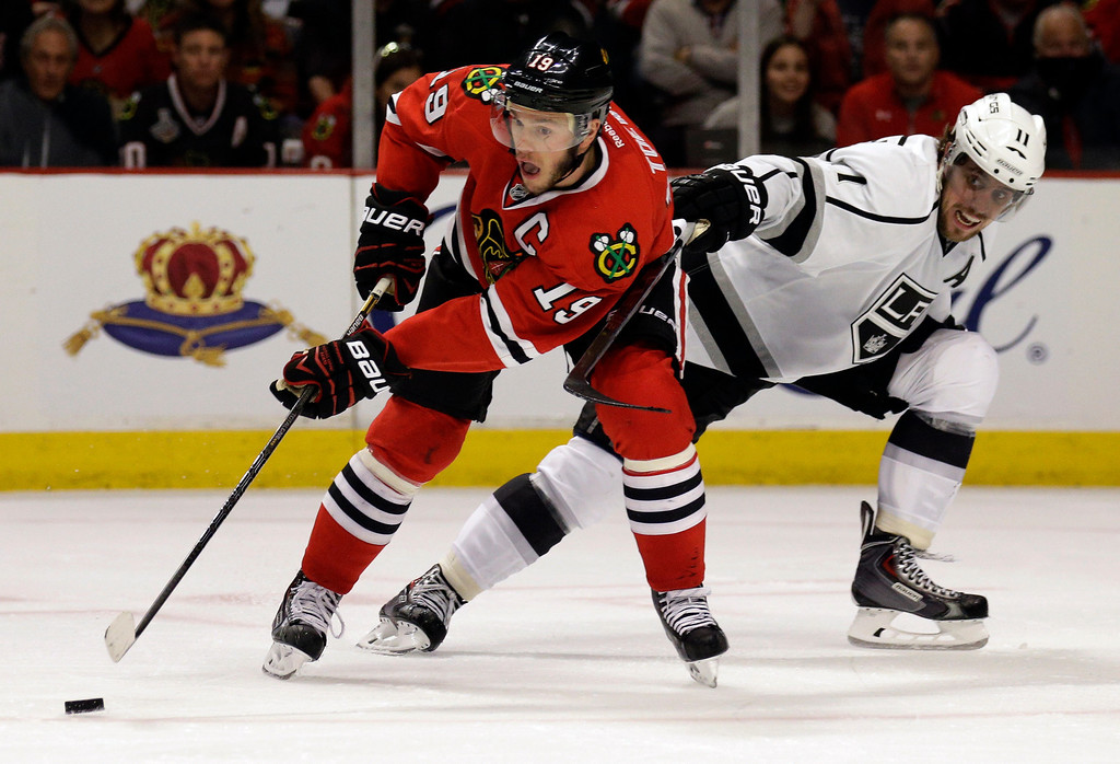 . Chicago Blackhawks\' Jonathan Toews (19) controls the puck against Los Angeles Kings\' Anze Kopitar (11) during the second period in Game 1 of the Western Conference finals in the NHL hockey Stanley Cup playoffs in Chicago on Sunday, May 18, 2014. (AP Photo/Nam Y. Huh)