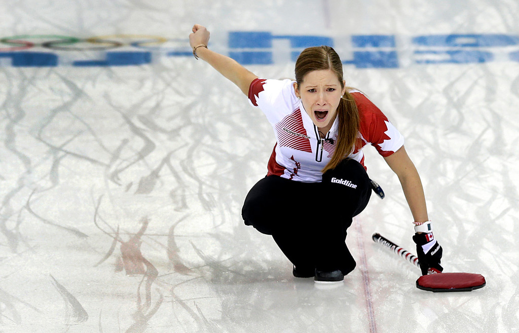 . Canada\'s Kaitlyn Lawes shouts instructions to her teammates during the women\'s curling semifinal game against Britain at the 2014 Winter Olympics, Wednesday, Feb. 19, 2014, in Sochi, Russia. (AP Photo/Wong Maye-E)