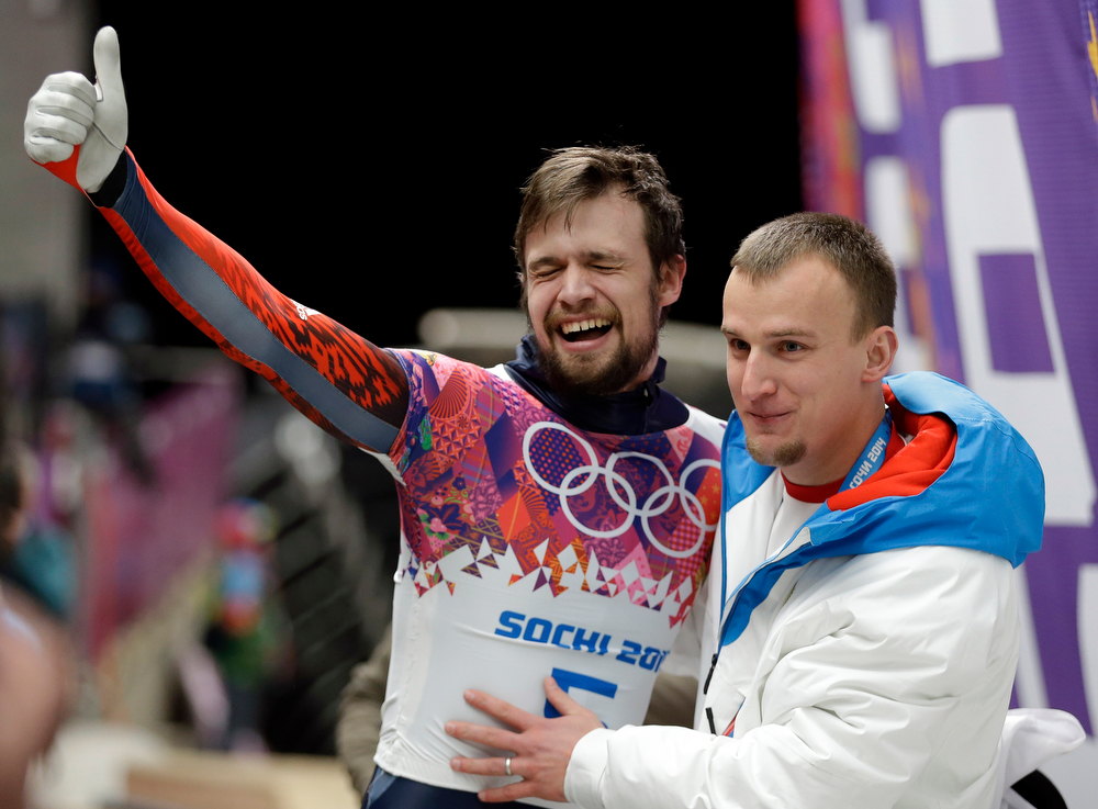 . Alexander Tretiakov of Russia celebrates in the finish area after he won the gold medal during the men\'s skeleton competition at the 2014 Winter Olympics, Saturday, Feb. 15, 2014, in Krasnaya Polyana, Russia. (AP Photo/Natacha Pisarenko)